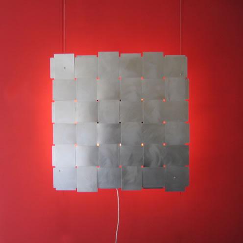 sleek urbane and cosmopolitan this stainless steel wall. Black Bedroom Furniture Sets. Home Design Ideas