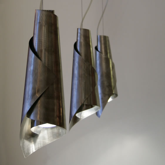 Multi-pendant design lights stainless steel and hanging fixture.