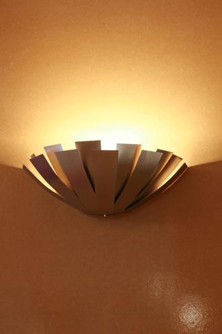 Design wall light directing light upward providing ambient light